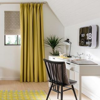 Floor-to-ceiling Tetbury Mustard Curtains in home office with desk and chair to the right