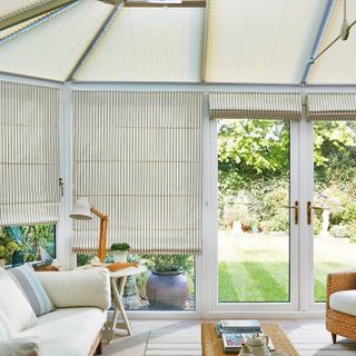 Roman side blind_Downtown Blue_with_Elba Cream Pleated roof blind_Conservatory