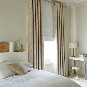 Beige Eyelet Curtains with a White Roman Blind in the bedroom - Bamboo Linen Curtains and Mineral Chalk Roman Blind