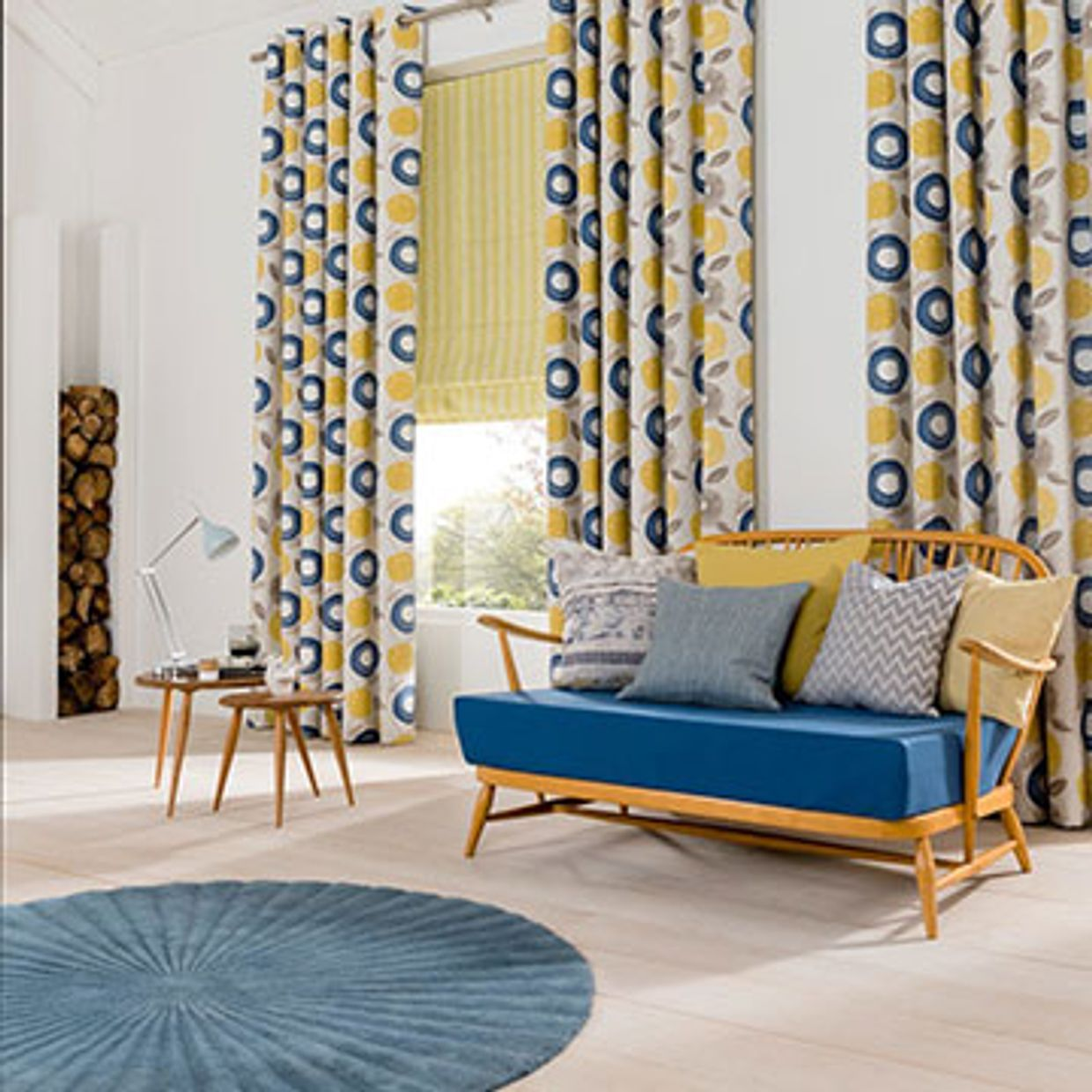 Yellow and blue patterned made to measure curtains combined with a yellow roman blind in the dining room - Freyja Mustard curtains and Lotta Citron roman blind