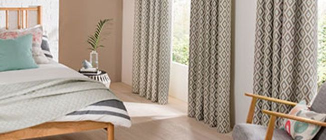 Laverne Glacier White Curtains on two windows in the bedroom