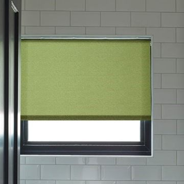Plain green Ravenna Moss roller blind hung in bathroom