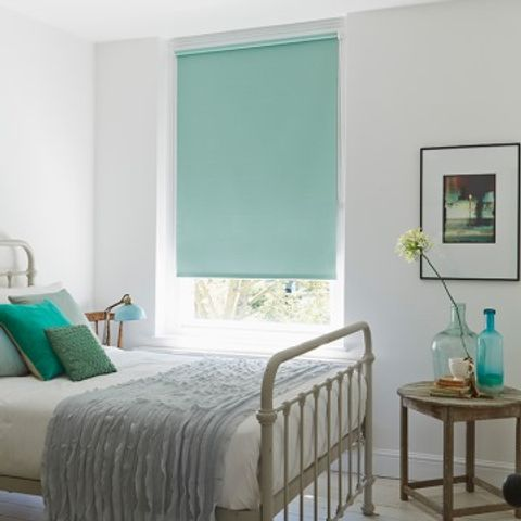 Duck egg blue Burma Eau De Nil roller blind hung in bedroom