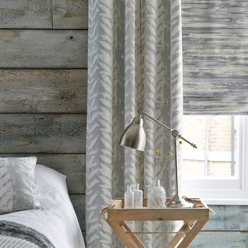 Isra Dove Grey curtains and Riviera Dusk roman blinds in the bedroom
