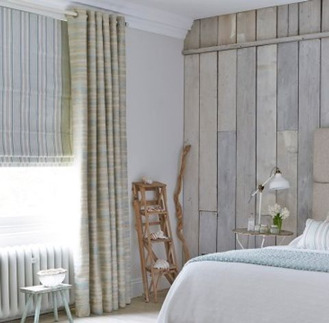 Weathered curtains in Riviera Mist and roman blinds in Hatti Mineral in the bedroom