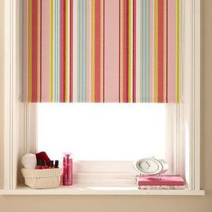 Striped pastel Circus Hot Pink roller blind hung in bedroom