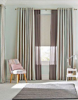 Anouk Blue Mist Curtains in large bedroom with chair in the corner and large grey rug