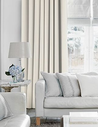 Arlington Pearl Curtains in living room with light grey sofa