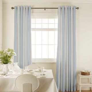 Hatti Chambray Curtains in dining room with white furniture
