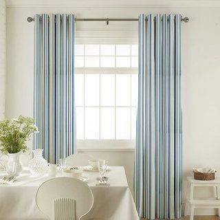 City Indigo Curtains in dining room with white furniture