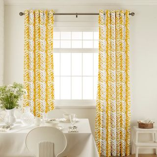 Isra Amber Curtains in dining room with white furniture