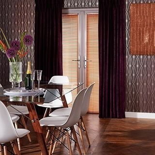 Lyon Plum Curtains in dark dining room with wooden floors and patterned wallpaper