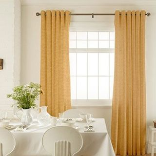 Roche Ochre Curtains in dining room with white furniture