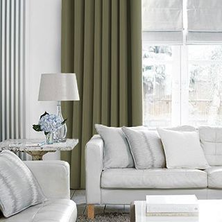 Tetbury Moss Curtains in living room with light grey sofa and furniture