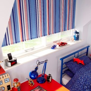 Blue Striped Circus Royal roller blind hung in child's bedroom