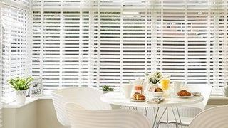Matte White Wood Illusion Blind in Conservatory with Dining Table and Chairs