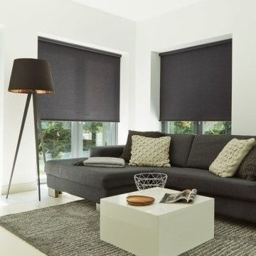 Plain dark Norfolk Charcoal roller blind hung in living room