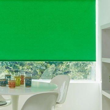 Green Roller Blinds in Acacia Emerald hung in kitchen