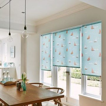 Boats Teal Roller Blinds hung in a dining room