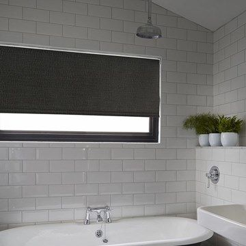 Waterproof roller blind in Iowa Black hung in bathroom