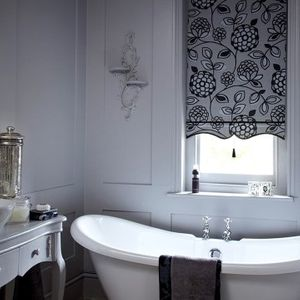 Black and white Serena Monochrome roller blind hung in bathroom