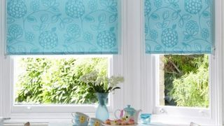 Serena Teal roller blind in dining room