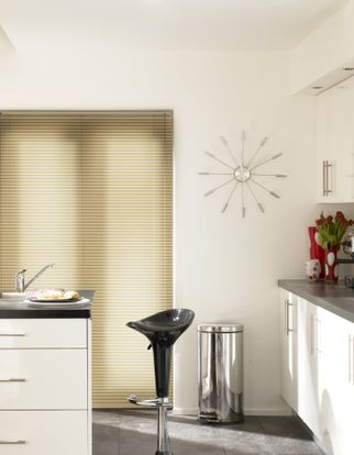 Light wood Aluwood Scottish Pine Venetian blinds hung in a modern kitchen