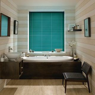 Green Portfolio Deep Ivy Venetian blinds in a cosy bathroom