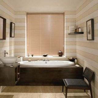 Light Portfolio Latte Venetian blinds in a cosy bathroom