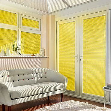 Yellow Portfolio Marigold Venetian blinds hanging in patio doors