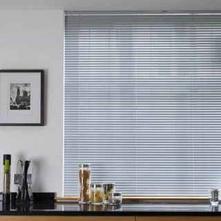 Portfolio Mid Grey Venetian blinds hung in a kitchen window