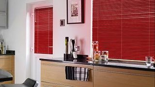 Red Portfolio Scarlet Venetian blinds hanging in a modern kitchen