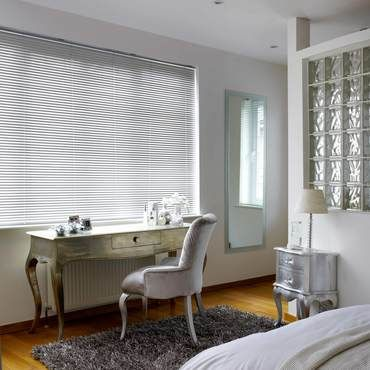 Sheer Luxury Brushed Mercury Venetian blinds in a glamorous bedroom