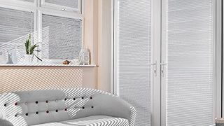 Light Sheer Luxury Pinstripe Venetian blinds hanging in patio doors