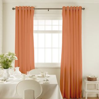 Islita Hot Spice Curtains in dining room with white furniture