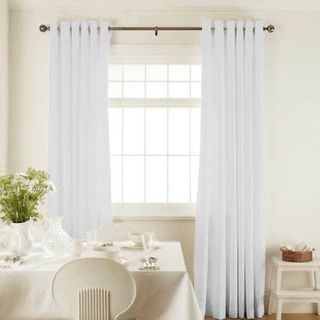 Islita Ice White Curtains in dining room with white furniture