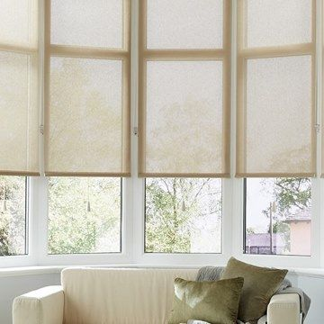 Tatum Beige roller blind hung in living room