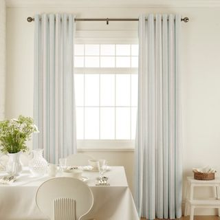 Hatti Mineral Curtains in dining room with white furniture