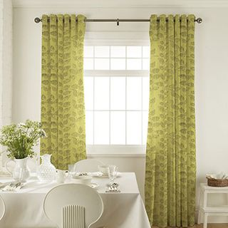 Roche Olive Curtains in dining room with white furniture