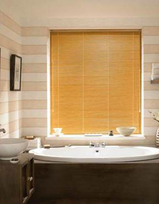 Aluwood Chestnut Venetian blinds hung in a cosy bathroom