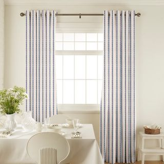 Downtown Blue Curtains in dining room with white furniture