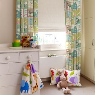 Farm Animals Pastel Curtains in Children's Bedroom with set of drawers and toys