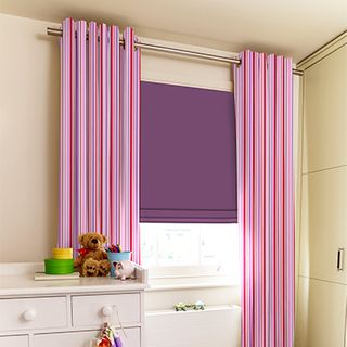 Lollipop Blush Curtains paired with purple roman blinds in children's bedroom