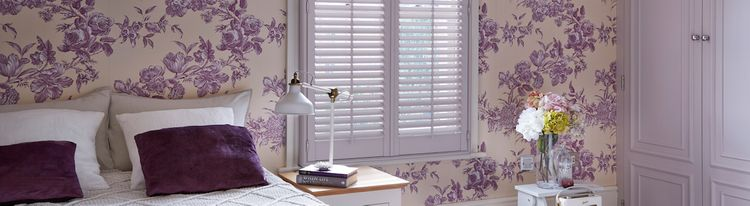 full height white shutters in bedroom