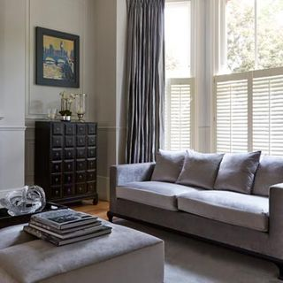 Cafe Style White Shutters In the Living Room