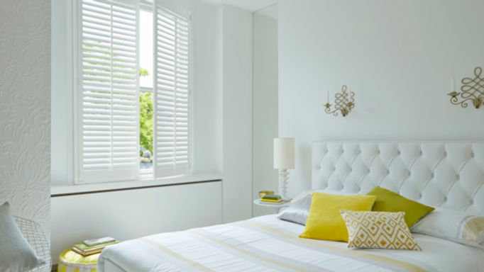white shutters in the bedroom