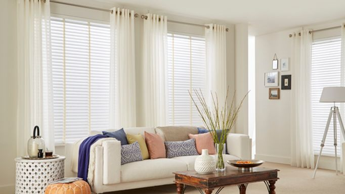 Light and Airy Living Room with Colourful Cushions and Sheer Voile Curtains in Lyra White Fabric