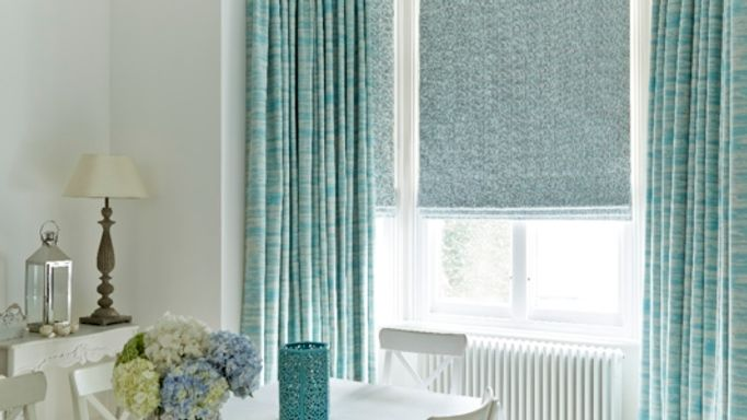 Riviera Turquoise curtains and Daze Peacock Roman blinds