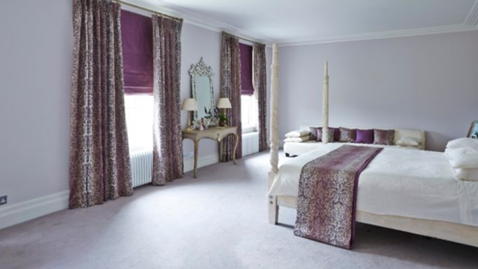 Purple curtains and roman blinds bedroom