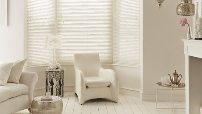 Cream Wooden blinds used in a living room to control light